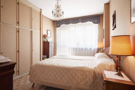 queen bed: Old bedroom with queen size bed in cozy house