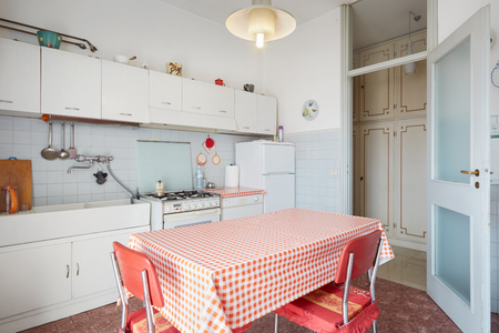 red kitchen: Old kitchen interior in normal house Stock Photo