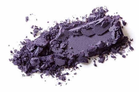 Dark purple eye shadow crushed on white background