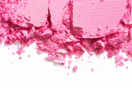 beauty products: Pink eye shadow border crushed on white background Stock Photo
