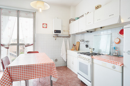 red kitchen: Old kitchen in normal house interior