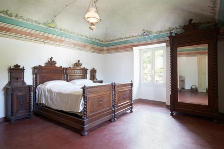 queen bed: Wooden bedroom in ancient house with fresco