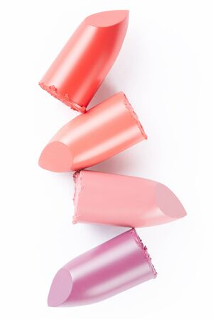 the lipstick: Lipstick cut collection in red, coral, pink and purple colors on white, clipping path Stock Photo