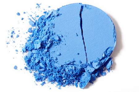 eyes close up: Blue eye shadow, crushed cosmetic on white