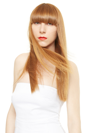 straight path: Blond hair. Young woman with long, straight hair in wind on white, clipping path Stock Photo