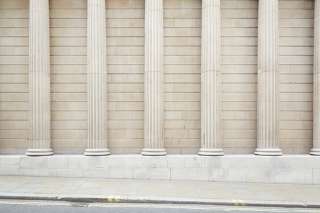 strong base: White classical columns and wall background with sidewalk floor