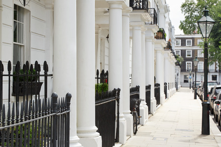house facades: Row of beautiful white edwardian houses in Kensington, London