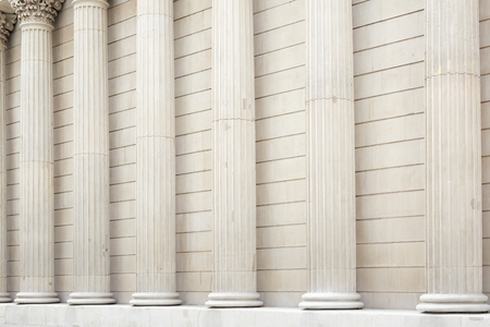 strong base: White classical columns and wall background Stock Photo