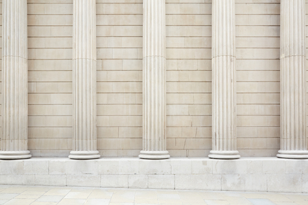 strong base: White classical columns and wall background with stone floor