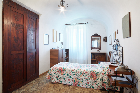 house with style: Old, single bedroom in ancient italian house Stock Photo