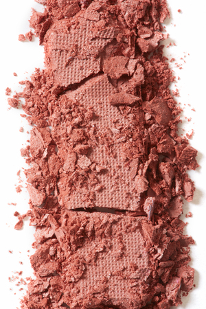 brown eye: Brown eye shadow cosmetic crushed, close up on white