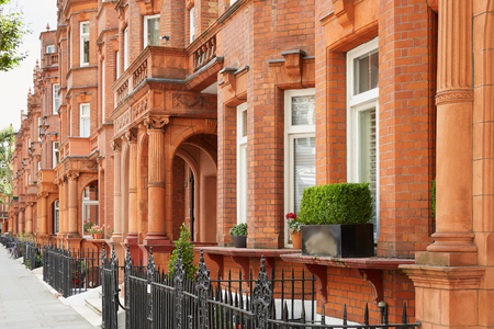 districts: Red bricks houses in London, english architecture Stock Photo