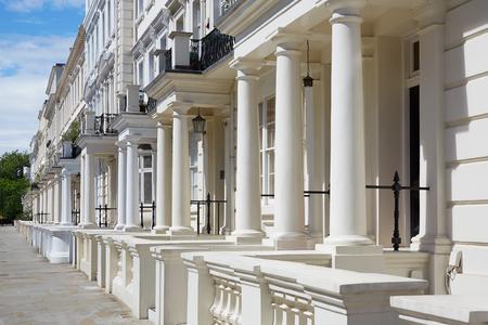 sidewalk sale: White, english luxury houses facades in London Stock Photo