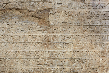 hieroglyphs: Egyptian hyerogliphs writing on old broken stone background Stock Photo