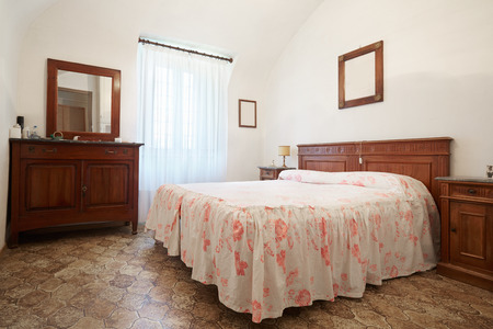 queen bed: Old bedroom with queen size bed in ancient italian house