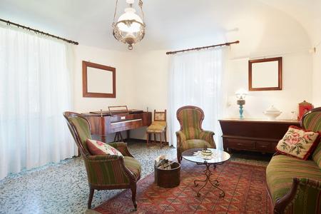 room decor: Living room with antiquities, italian interior