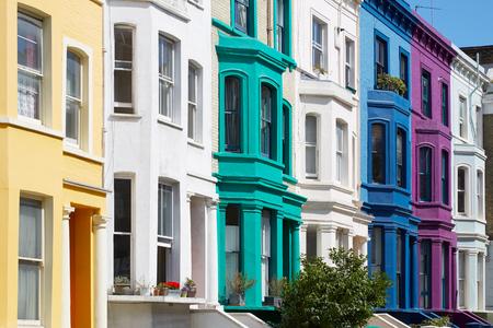 Colorful english houses facades in London near Portobello road in a sunny day