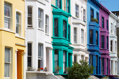 Colorful english houses facades in London near Portobello road in a sunny day