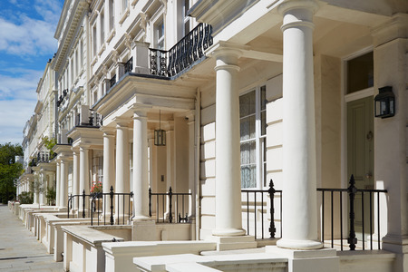 White luxury houses facades in London, perspective view