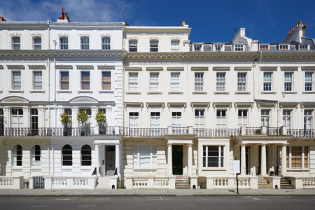 row of houses: White luxury houses facades in London, Kensington and Chelsea architecture