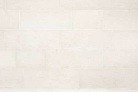 beige: Beige tiled stone wall texture background
