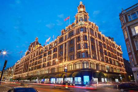 knightsbridge: The famous Harrods department store in the evening in London