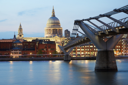 saint pauls cathedral: St Pauls cathedral and Millennium bridge in London in the evening Stock Photo