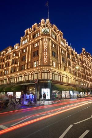 knightsbridge: The famous Harrods department store illuminated at night in London