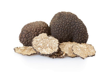 Black truffles group and slices on white, clipping path Stock Photo