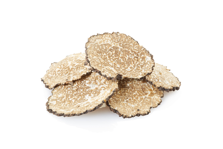 Black truffle slices heap on white, clipping path Stock Photo