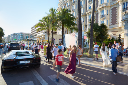 lamborghini: Cannes, people walking in a summer afternoon along the Croisette boulevard