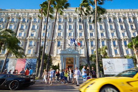 intercontinental: Cannes, people walking and luxury cars in front of hotel InterContinental Carlton Editorial