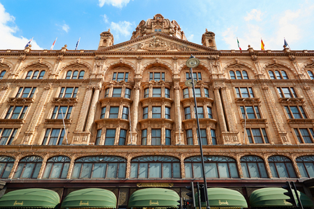 knightsbridge: Harrods department store building facade in a summer afternoon in London