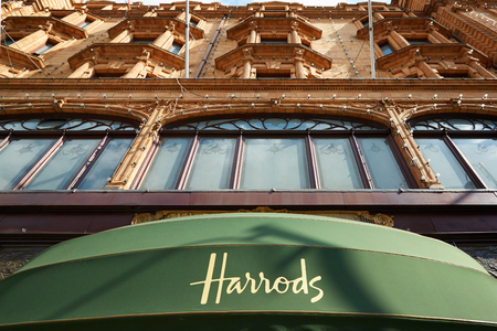 knightsbridge: Harrods department store building in a summer afternoon in London