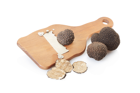 Black truffles, slices and wooden truffle slicer on white, clipping path Stock Photo - 50332644