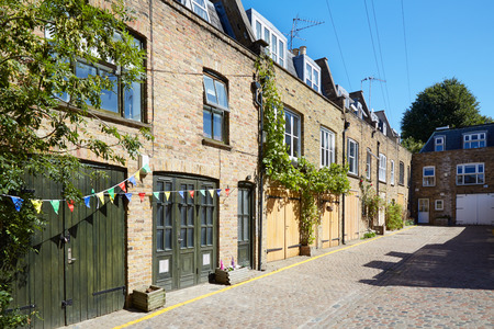 typically british: Bricks mews houses in London in a sunny day, England