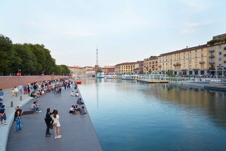 Milan new Darsena, redeveloped docks area in the afternoon, people walking