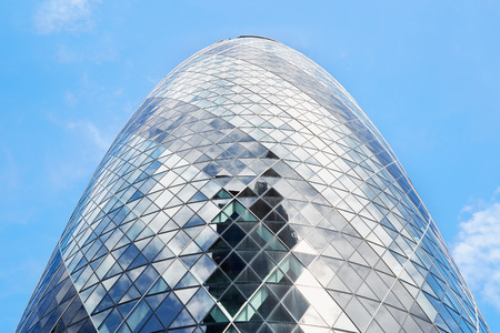 30 st mary axe: 30 St Mary Axe building or Gherkin in the morning on August 9, 2015 in London. The skyscraper designed by architect Norman Foster is one of citys most widely recognized examples of contemporary architecture Editorial