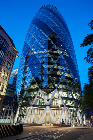 30 st mary axe: 30 St Mary Axe building or Gherkin illuminated at night in London on August 9, 2015. The skyscraper designed by architect Norman Foster is one of citys most widely recognized examples of contemporary architecture Editorial