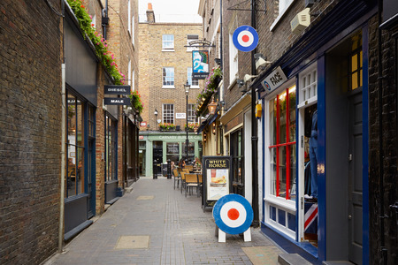pub: Typical Newburgh street with brick houses and pub near Carnaby street in London, UK Editorial