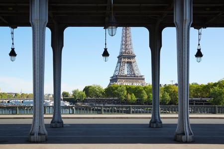 bir: Bir Hakeim bridge and Eiffel tower in Paris in a sunny day
