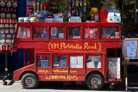 souvenir: Portobello road souvenir shop with red London bus model in London