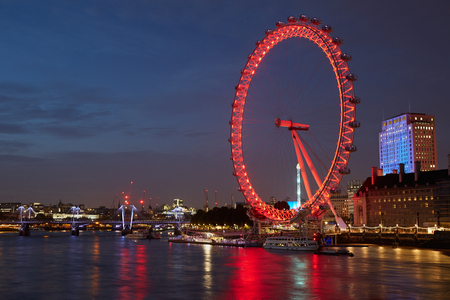 wheel house: London eye, ferris wheel, illuminated in red and Thames river view in the night in London Editorial