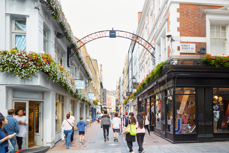 Carnaby street, famous shopping street with people in London