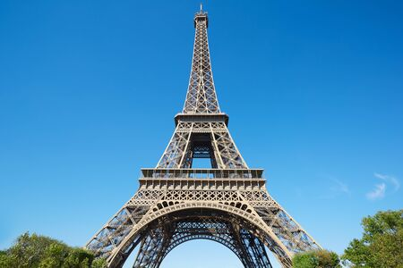 low angle views: Eiffel tower, sunny summer day with blue clear sky in Paris Stock Photo