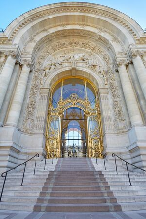 petit: Petit Palais palace, beautiful decorated entrance with stairway in Paris