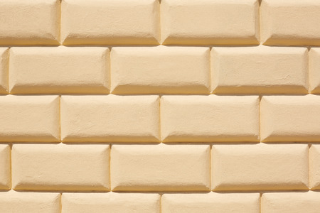 tiled: Yellow tiled wall texture background in sunlight Stock Photo