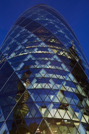 30 st mary axe: 30 St Mary Axe building or Gherkin illuminated at night in London Editorial