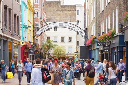 famous people: Carnaby street, famous shopping street with people in London