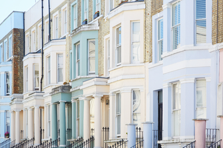 old building facade: Pastel color houses facades in London Stock Photo